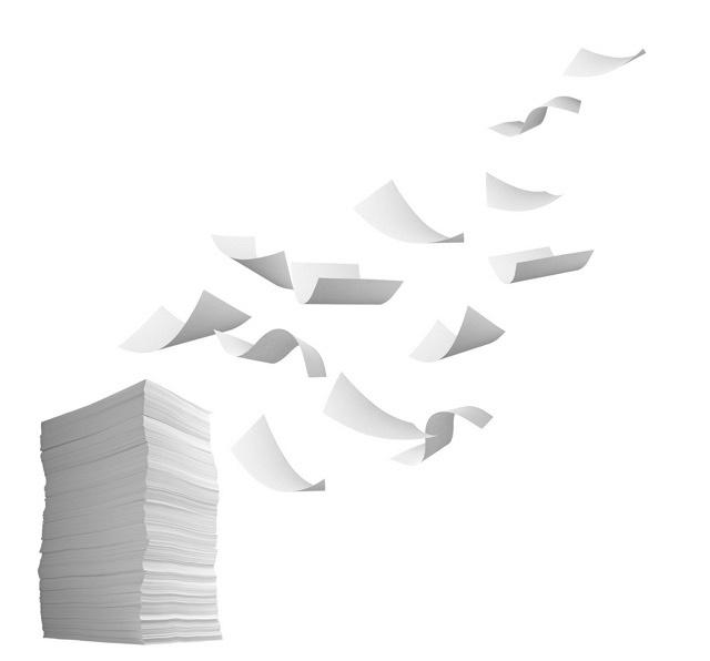 stack of papers and curl paper flying in wind office business